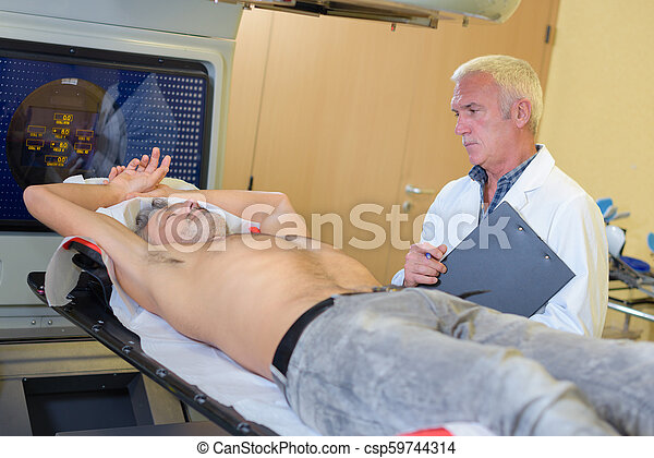 doctor examinating a patient at the hospital - csp59744314