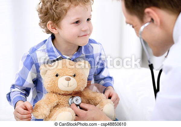 Doctor examining a child  patient by stethoscope - csp48850610
