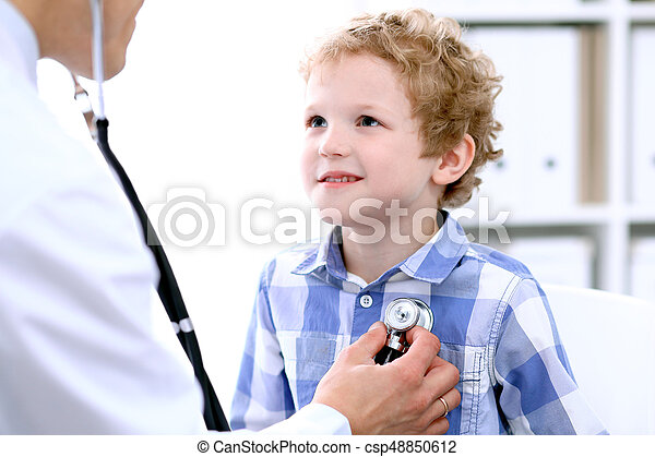 Doctor examining a child  patient by stethoscope - csp48850612