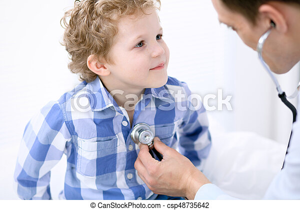 Doctor examining a child  patient by stethoscope - csp48735642