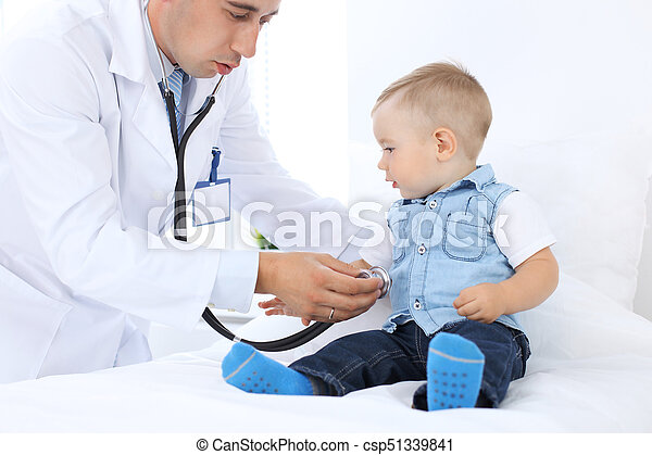 Doctor examining a child  patient by stethoscope - csp51339841