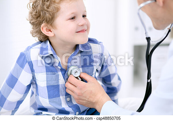 Doctor examining a child  patient by stethoscope - csp48850705