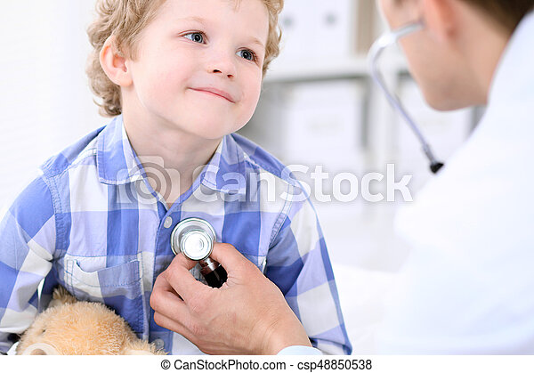 Doctor examining a child  patient by stethoscope - csp48850538
