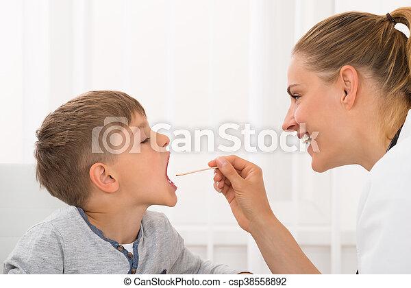 Doctor Examining Boy's Mouth - csp38558892