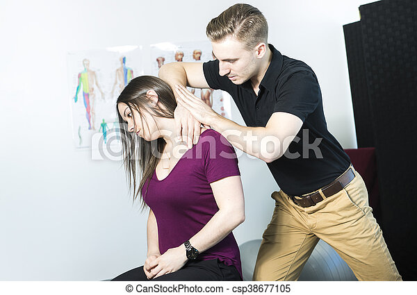 Doctor examining his patient neck in medical office - csp38677105