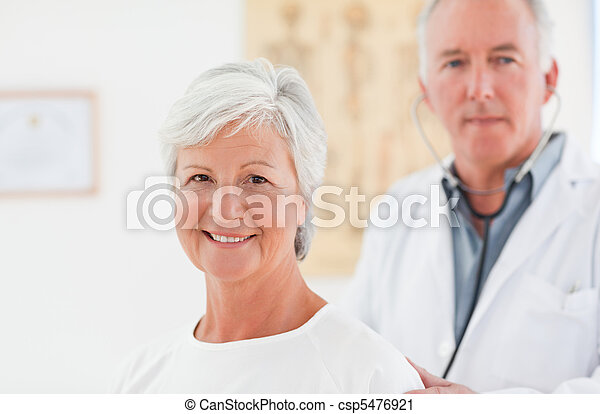 Doctor examining his patient - csp5476921