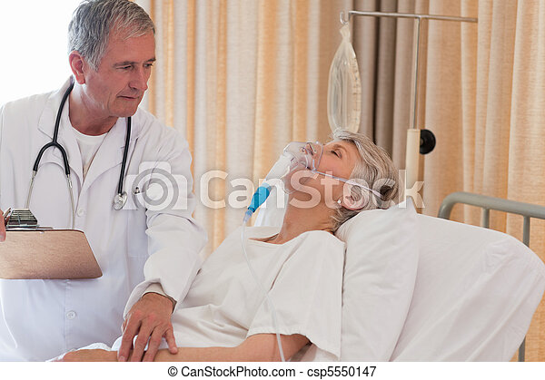 Doctor examining his patient - csp5550147