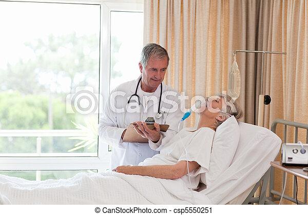 Doctor examining his patient - csp5550251