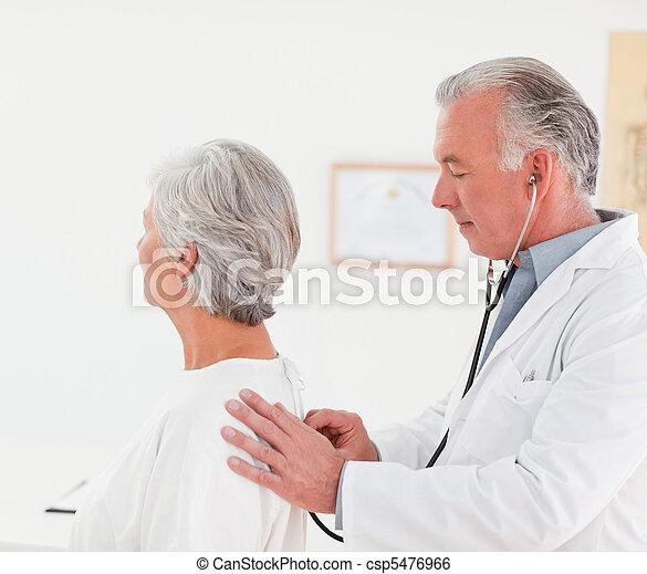 Doctor examining his patient - csp5476966