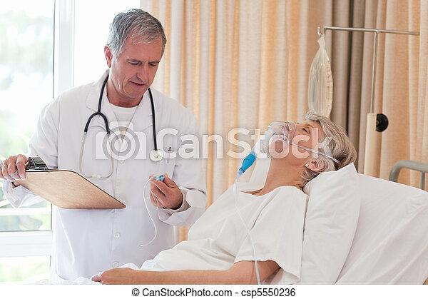Doctor examining his patient - csp5550236