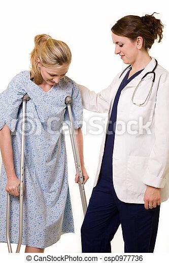 Doctor helping patient - csp0977736