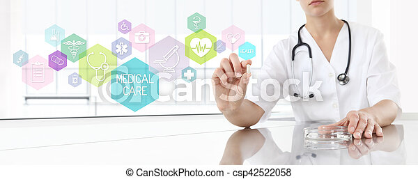 Doctor holding pill medicine with pink icons. Health care and medical concept - csp42522058