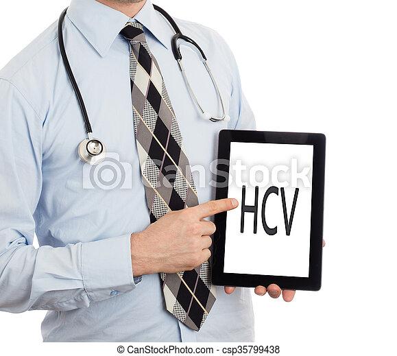 Doctor holding tablet - HCV - csp35799438