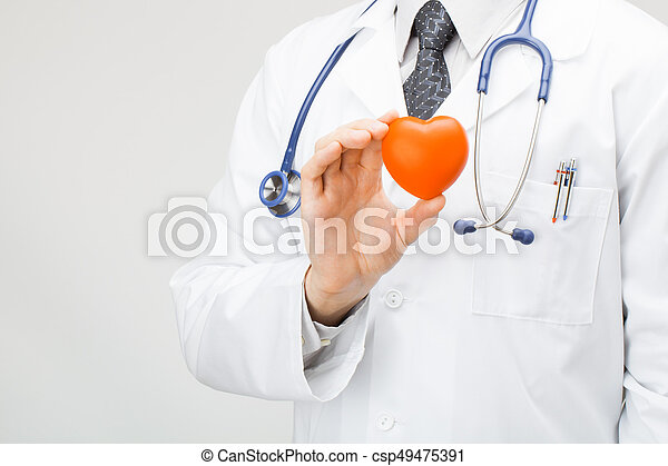 Doctor holding toy-heart in his hand - csp49475391