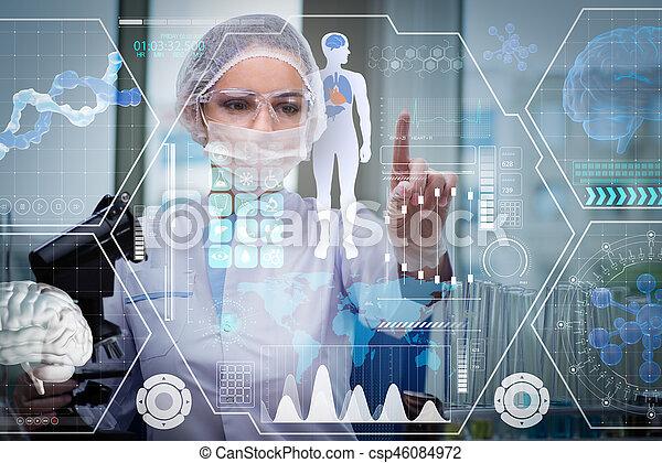 Doctor in futuristic medical concept pressing button - csp46084972
