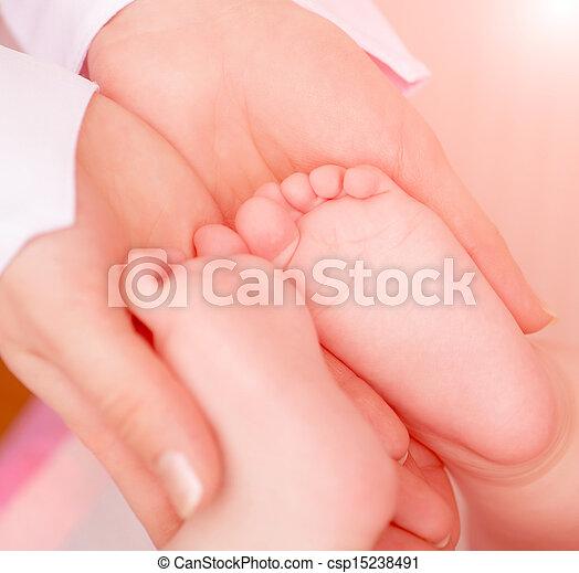 Doctor massaging  baby - csp15238491