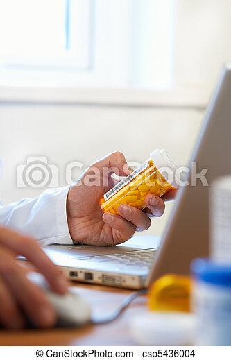 Doctor preparing online internet prescription drugs - csp5436004