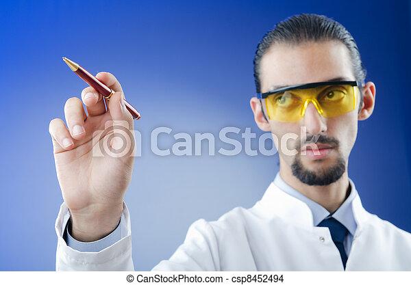 Doctor pressing virtual button - csp8452494