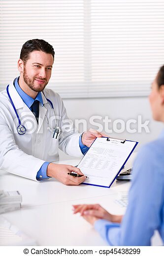 Doctor requesting the signature of a patient - csp45438299