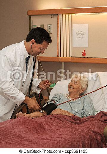 doctor taking senior blood pressure - csp3691125