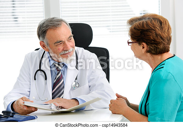 Doctor talking to his female patient - csp14943584