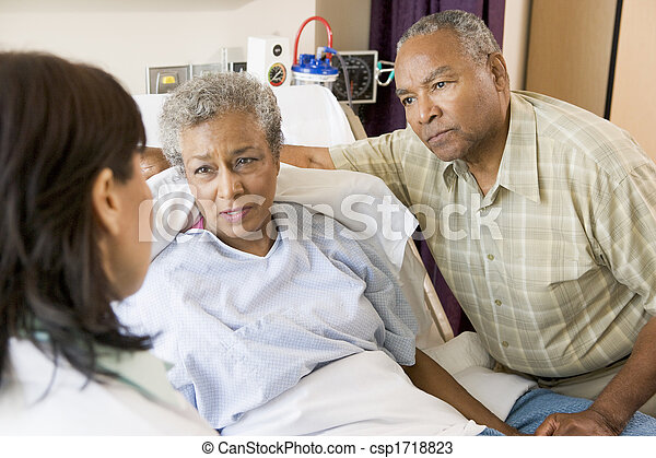 Doctor Talking To Senior Couple - csp1718823