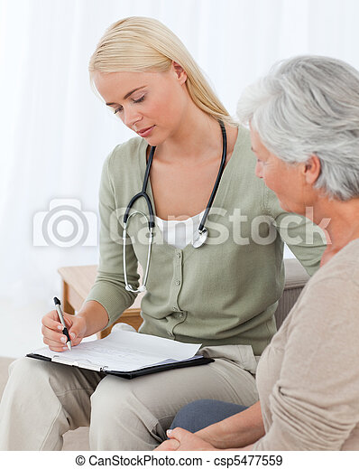 Doctor talking with her patient - csp5477559