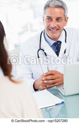 Doctor talking with his patient  - csp15207280