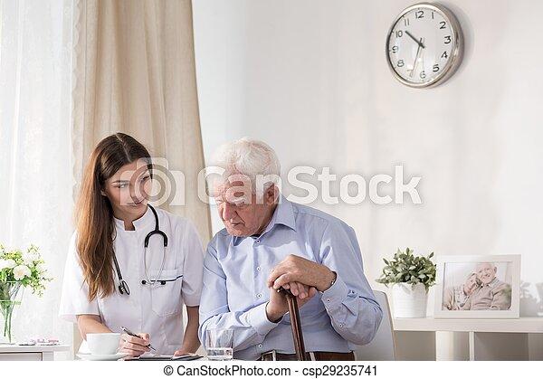 Doctor talking with senior man - csp29235741