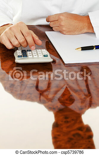 Doctor with a calculator. Costing medical practice - csp5739786