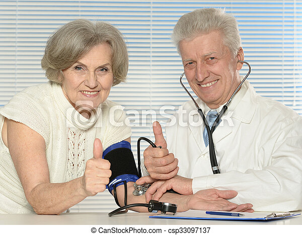 doctor with a patient - csp33097137