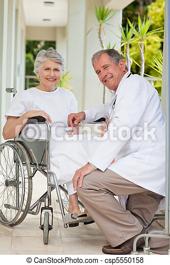 Doctor with his patient looking at  - csp5550158