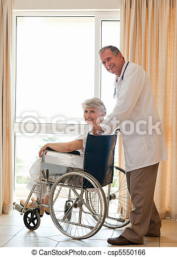 Doctor with his patient looking at  - csp5550166