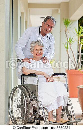 Doctor with his patient looking at the camera - csp5550221