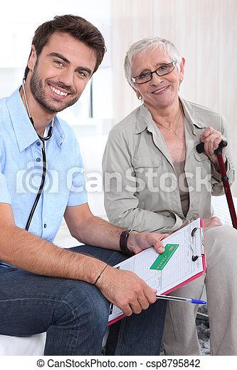 doctor with his patient - csp8795842