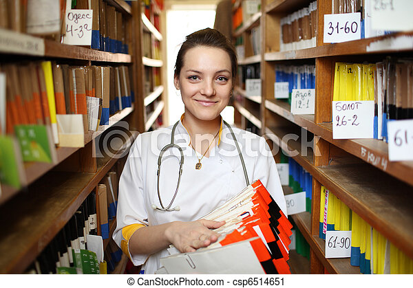 Doctor with medical records - csp6514651