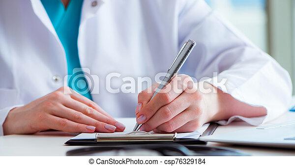Doctor with prescribed medicines in medical concept - csp76329184