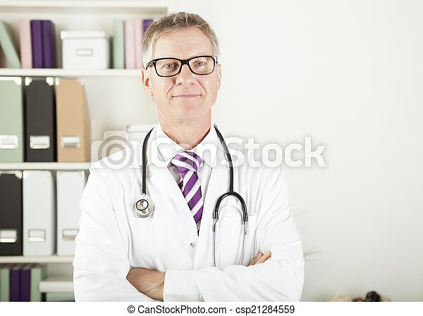 Doctor with stethoscope around his neck looking at the camera - csp21284559