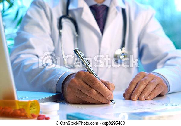 Doctor writing prescription  - csp8295460