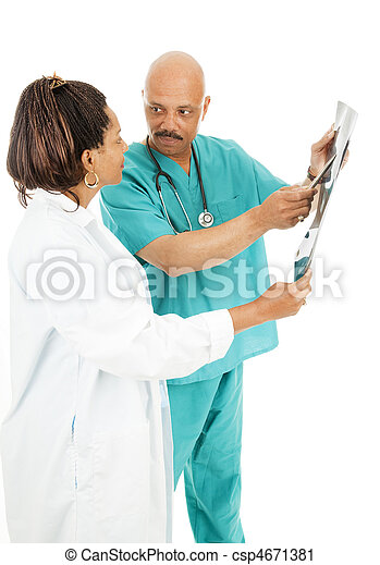 Doctors Discuss X-Ray Results - csp4671381