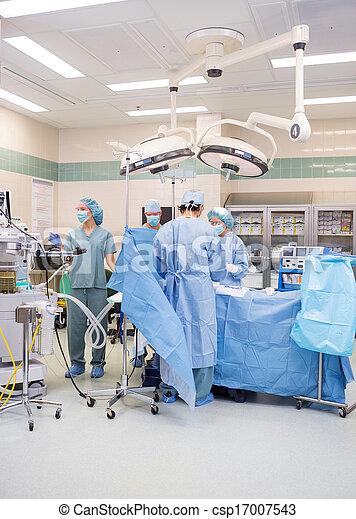 Doctors Operating Patient - csp17007543