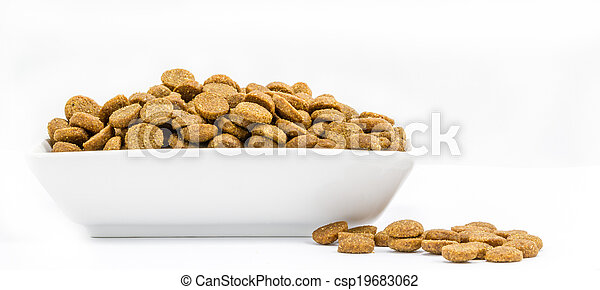 Dog food in a bowl on white background - csp19683062