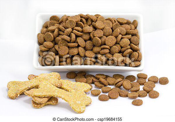 Dog food in a bowl on white background - csp19684155