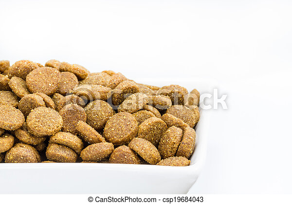 Dog food in a bowl on white background - csp19684043
