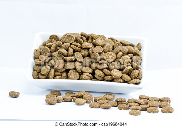 Dog food in a bowl on white background - csp19684044