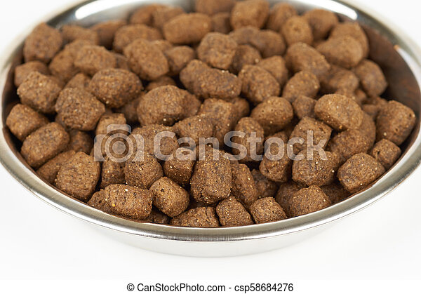 Dog food in bowl - csp58684276