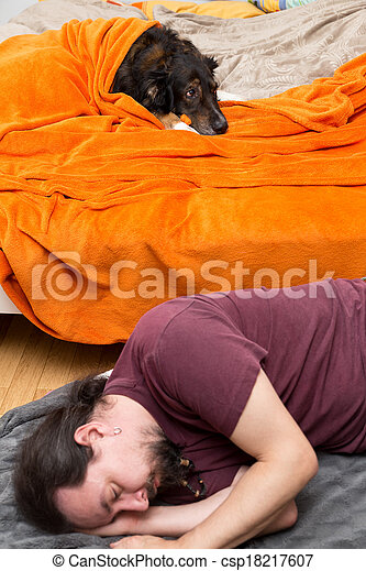 Dog in the Bed, Man sleeping on the ground - csp18217607