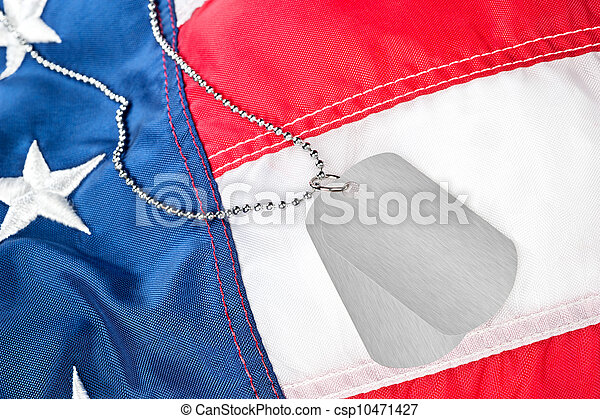 Dog tags on American flag - csp10471427