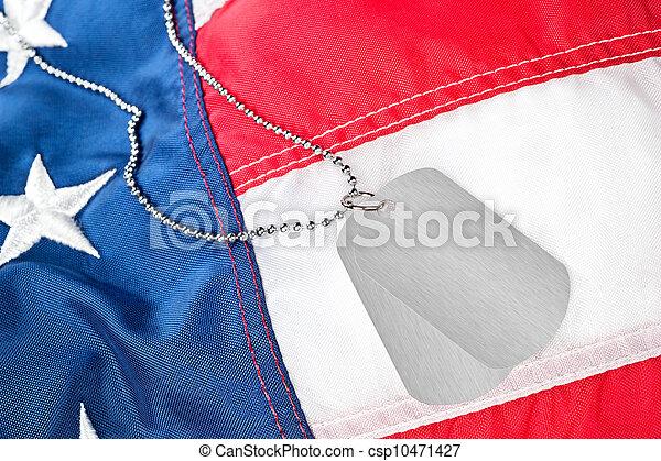 Dog tags on American flag - csp10471427