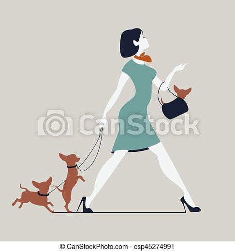 Una joven paseando perros. Moda con perros - csp45274991
